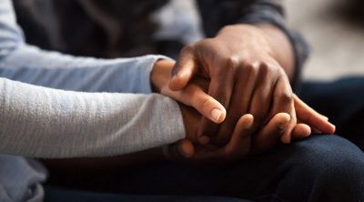 Holding hands, showing compassion