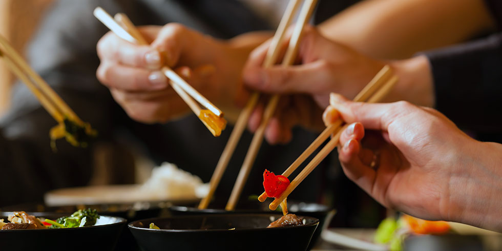 Eating a meal with chopsticks