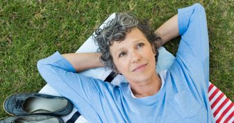 Middle aged woman relaxing on ground