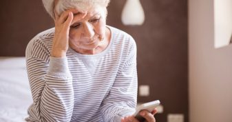 Senior woman seeing no answer on cell phone