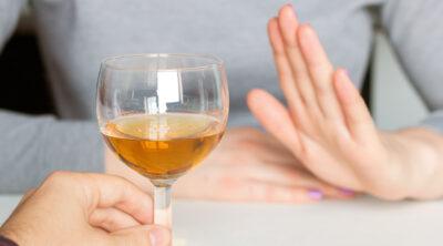 Woman refusing a drink