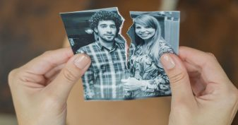 Tearing up photo of couple